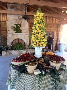 Fruit and cheese table with a lemon topiary centerpiece - catered by The Dove's Nest