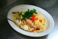 Seafood Fettuccine Shrimp, scallops, and lobster meat over fettuccine with sauce Newburg