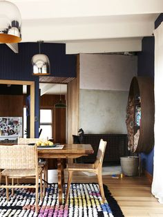 Kip & Co. Founder Kate Heppell's home featured in The Design Files // Dining space with wooden furniture and a patterned rug