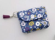 A small coin purse with a key ring for holding a few essentials on the go. How to sew