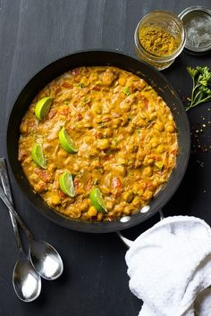 This Creamy Vegan Coconut Chickpea Curry is the BEST curry I've ever had! It's loaded with homemade grinded spices and incredily flavorful!: