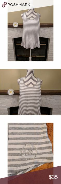 MICHAEL Michael Kors Basics T-Shirt Striped Tank NWT MICHAEL Michael Kors Basics T-Shirt Striped Tank in gray and white, size XL.   - Silver tone MK studded logo on the bottom left corner - 95% Cotton 5% Elastane - MSRP $59.50  Smoke-free home  Bundle your likes for a personalized, no obligation offer, or, use the offer button and submit your own! MICHAEL Michael Kors Tops Tank Tops