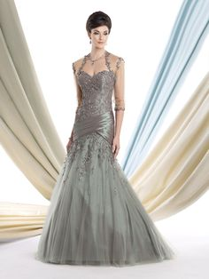 Multi-piece tulle over taffeta gown set, strapless trumpet gown with sweetheart neckline, hand-beaded lace bodice with pleated crisscross taffeta dropped waistline, matching bolero jacket with elbow-length sleeves and trimmed with hand-beaded lace. Matching shawl and removable straps included. Sizes: 4 – 20