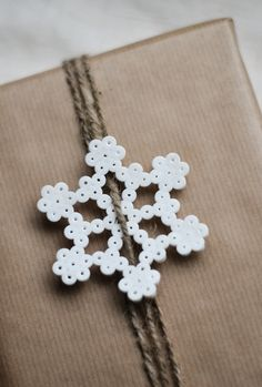 Hama bead snowflake for gift wrapping Hama Beads Design, Hama Beads Patterns, Beading Patterns, Noel Christmas, Winter Christmas, Christmas Ornaments, Xmas, Hama Beads Christmas, Iron Beads