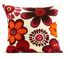 Anna Printed Cushion  This cotton cushion is printed with a bold floral design using a warm colour palette of burnt orange and reds.