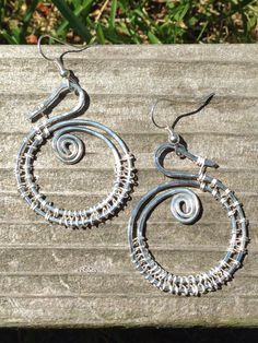 "Silver Fishtail Swirls #1,1 1/2"" long from the bottom of the earring hook ball, $20"