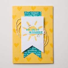 The new Over the Rainbow stamp set is both cute and versatile.  Sunshines and rainbows are certain to make people happy.