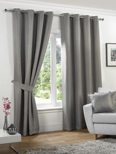 Neva blackout eyelet curtains in silver