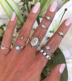 We love this pale pink shade and mother of pearl midi rings!