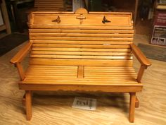 """(SOLD) A handcrafted Bench with curved back made of """"Cypress"""" It is adorned with a Cross and 2 Doves."""