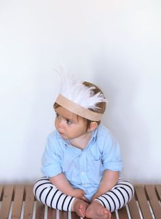 striped leggings, blue button up and headdress.