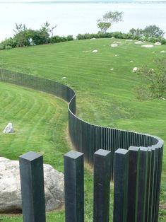 modern landscape wave shaped garden fence ideas