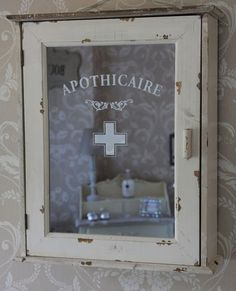 Vintage medicine cabinet. With the etching products available today, this would be a piece of cake to reproduce.