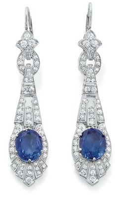 A Pair of Art Deco Sapphire and Diamond Ear Pendants  Each designed as an openwork, articulated pendant drop, set with an oval-cut sapphire, weighing approximately 8.00 carats total, mounted in platinum, length 2 1/2 inches. Sold for 32k