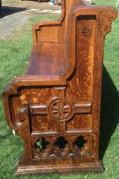 We restored this 19C Gothic pew. Both the tiger oak wood grain and carved design are outstanding!