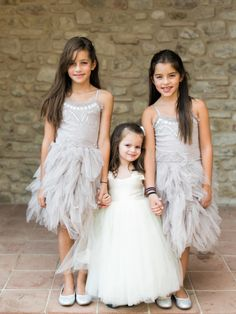 Adorable poofy tulle flower girl dresses: http://www.stylemepretty.com/2015/11/18/classic-tuscan-villa-wedding/   Photography: Katie Grant - http://www.katiegrantphoto.com/