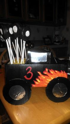 Oreo tire pops, and tire cake pops in a shoe box painted to look like a monster truck. Awesome for a monster truck birthday party