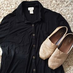 Black Button Up Shirt Black button up shirt. Made of 100% rayon. Very soft material. Brown buttons. Great casual business look. Tops Button Down Shirts