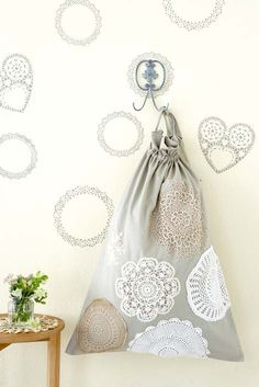 Add a bit of feminine laciness to this laundry bag.