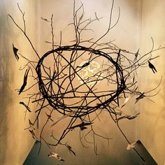 Flight Behavior  by lori vrba  tree branches, cut up photographic prints and string