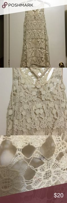 Lauren Conrad crochet dress Such a cute dress. Perfect for summer time. Size small but could definitely fit a medium. Comes with attached slip underneath. I took a picture of a small stain, I haven't tried taking it out but I'm sure it's possible. LC Lauren Conrad Dresses Mini