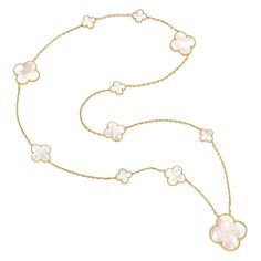 Magic Alhambra eleven motif long necklace with very large central motif in 18kt yellow gold with mother-of-pearl.