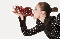 Emily DiDonato eats some grapes in polka dot print top