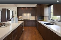 White quartz countertop with dark cabinets. Modern. The floors need to be different though