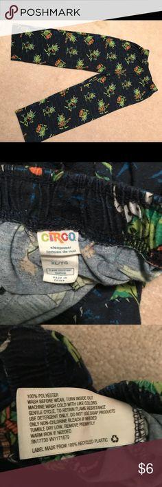 Boys sleepwear bottom. XL/TG Boys sleepwear bottom. Brand, CIRCO, XL/TG 100% polyester, flame resistant.Dark blue with characters CIRCO Pajamas Pajama Bottoms