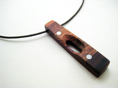 wood pendant with aluminum accents exposure by RamshackleStudio