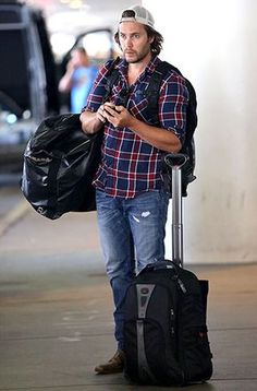 He looks good in that flannel! Following a trip to Austin, Tex., Taylor Kitsch paused after landing at LAX airport.