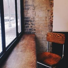 I would love this kind of desk and corner!  Love that wood, exposed brick, and window!  But I do not like the chair ... I would require something a little more comfortable.
