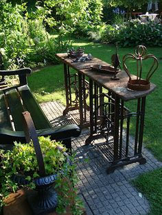 Old sewing machine tables as garden furniture. LOVE…