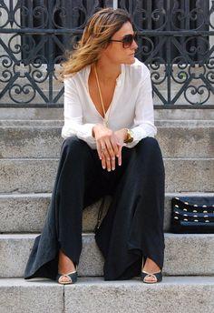 White shirt, black Palazzo pants in Madrid | Chicisimo
