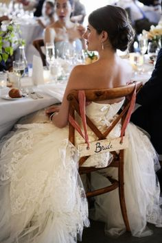 first, i love the her dress to pieces. second, i like the bride sign and  the fabric holding the sign