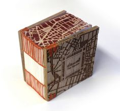 The Square, Al Midan by Islam Aly. 2014. Laser Cut, edge painting, laser etching. Edition of 40. 20 sections, each section four folios, total of 160 pages. 4.5 x 4.5 x 2.5 inches
