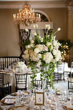 Tall White Wedding Centerpiece - to do with no ivy, but still lush white & tall