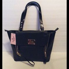 """Juicy Couture Black Zelda Tote Bag NWT Juicy Couture Black Zelda Tote. Inside zipper pocket, inside slip pockets, outside front snap compartment, outside back zipper pocket. Zipper closure. 12"""" x 10"""" x 5"""" handle strap drop 10"""". NWT Juicy Couture Bags Totes"""