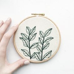 dark green botanical plant hand embroidery hoop by tuskandtwine