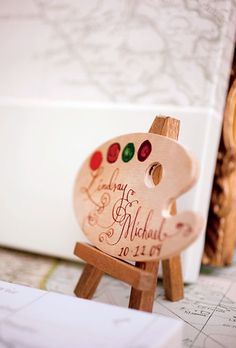 The couple used an artist's palette as their wedding sign. Photo: Mel Barlow and Allan Zepeda.-- for an art party Art Wedding Themes, Wedding Art, Wedding Tips, Destination Wedding, Wedding Venues, Wedding Planning, Wedding Decorations, Luxury Wedding, Wedding Dress