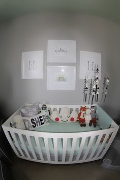 Mint and grey color scheme with a tribal theme. Perfect baby boy's nursery