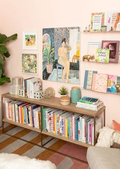 happy space: traci's library - Oh Joy! Urban Outfitters Daybed, Target Throw Blanket, West Elm Rug, Ceiling Shelves, Image Deco, Bookshelf Styling, Cozy Place, Hanging Art, Home Decor Trends