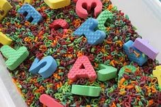 alphabet search -- good way to use those foam letters! Could add 2-3 letter word cards & see how she does...
