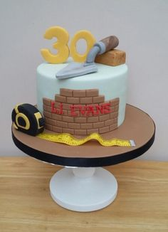 A bit of a change from the girly cakes was this one for Liam who has his own building company . . . All edible except for the ribbon tape!