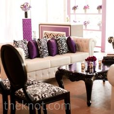 Cream tuffed sofa.. Absolutely love the pillows. Especially the color combination. Plum, cream, & black
