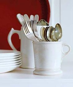Repurpose Mugs as Utensil Holders | Coffee mugs make an earthy, less generic-looking alternative to those divided plastic utensil holders for buffet tables and kitchen cupboards. The handles make them easy to transport.