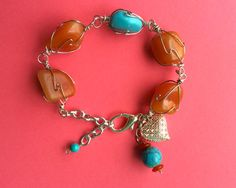 $16.00.  Carnelian and Magnesite Bracelet by my favorite Etsy vendor.  Love this.  Bargain.
