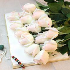 10 white roses $16.14