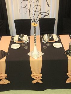 Table settings.  I love the 2 contrasting colors, the ribbons spilling down the sides