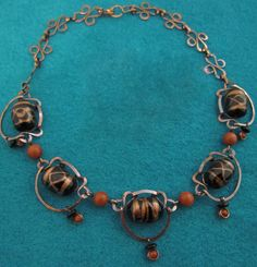 Antiqued, Hammered Copper Necklace With Vintage Black And Goldstone Beads.